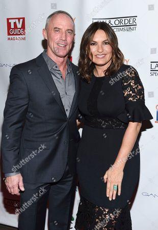 "Actors Robert John Burke, left, and Mariska Hargitay attend TV Guide Magazine's ""Law & Order: Special Victims Unit"" 400th episode celebration at the Gansevoort Park Avenue, in New York"