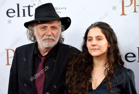 """Rade Serbedzija, left, and Nina Serbedzija arrive at the U.S. premiere of """"The Promise"""" at the TCL Chinese Theatre, in Los Angeles"""