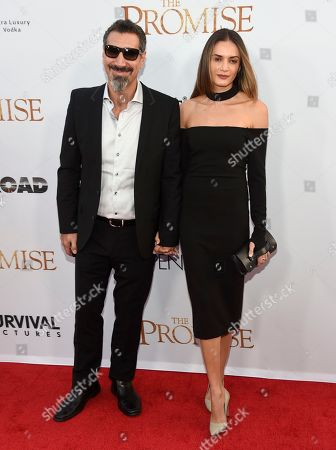 "Serj Tankian, lett, and Angela Madatyan arrive at the U.S. premiere of ""The Promise"" at the TCL Chinese Theatre, in Los Angeles"