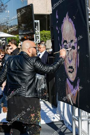 "Stock Photo of Painter David Garibaldi performs and paints a live painting at the UTA ""United Voices"" Rally at UTA headquarters, in Beverly Hills, Calif"