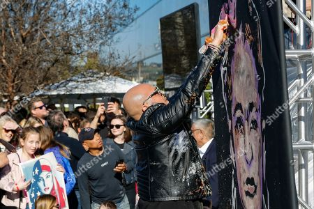 "Painter David Garibaldi performs and paints a live painting at the UTA ""United Voices"" Rally at UTA headquarters, in Beverly Hills, Calif"