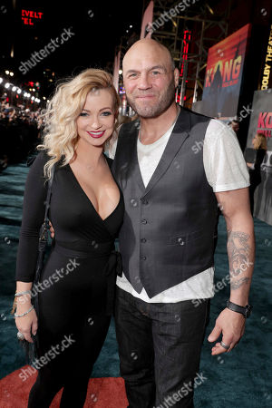 """Mindy Robinson and Randy Couture seen at Warner Bros. Pictures and Legendary Pictures Present the Los Angeles Premiere of """"Kong: Skull Island"""" at Dolby Theatre, in Los Angeles"""