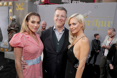 "Jacqui Ainsley, Writer/Producer Lionel Wigram and Poppy Delevingne seen at Warner Bros. World Premiere of ""King Arthur: Legend of the Sword"" at TCL Chinese Theatre, in Hollywood, CA"