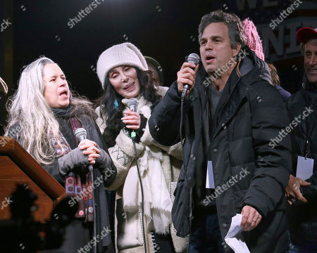 """Natalie Merchant, from left, Cher and Mark Ruffalo participate in the """"We Stand United: New York Rally to Protect Shared Values"""" on Thursday, Jan.19, 2017, in New York"""