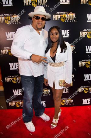 """DJ Hurricane, left, and Ayana Fite attend WE TV's """"Growing Up Hip Hop Atlanta"""" premiere screening at iPics Theaters, in New York"""