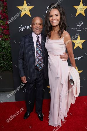 Stock Photo of Berry Gordy, left, and Eskedar Gobeze arrive at the Wolfgang Puck's Post-Hollywood Walk of Fame Star Ceremony Celebration at Spago, in Beverly Hills, CA