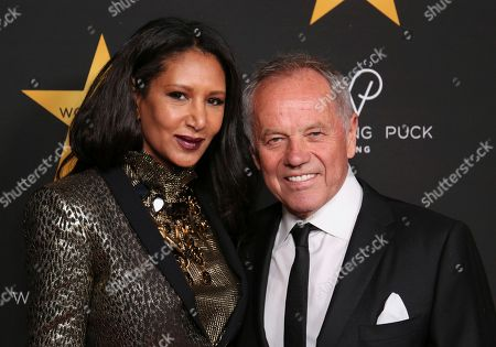 Gelila Assefa, left, and Wolfgang Puck arrive at the Wolfgang Puck's Post-Hollywood Walk of Fame Star Ceremony Celebration at Spago, in Beverly Hills, Calif