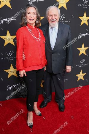 George Schlatter, right, and Jolene Schlatter arrive at the Wolfgang Puck's Post-Hollywood Walk of Fame Star Ceremony Celebration at Spago, in Beverly Hills, CA