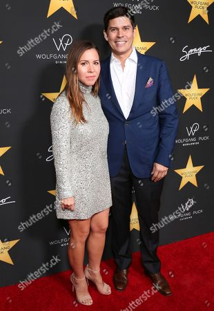 Monique Lhuillier, left, and Tom Bugbee arrive at the Wolfgang Puck's Post-Hollywood Walk of Fame Star Ceremony Celebration at Spago, in Beverly Hills, CA