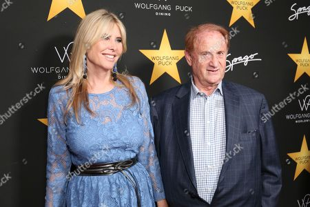 Mike Medavoy, right, and Irena Medavoy arrive at the Wolfgang Puck's Post-Hollywood Walk of Fame Star Ceremony Celebration at Spago, in Beverly Hills, CA
