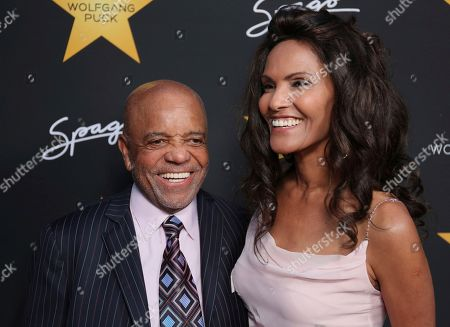 Berry Gordy, left, and Eskedar Gobeze arrive at the Wolfgang Puck's Post-Hollywood Walk of Fame Star Ceremony Celebration at Spago, in Beverly Hills, CA