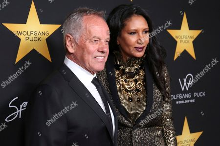 Wolfgang Puck, left, and Gelila Assefa arrive at the Wolfgang Puck's Post-Hollywood Walk of Fame Star Ceremony Celebration at Spago, in Beverly Hills, CA