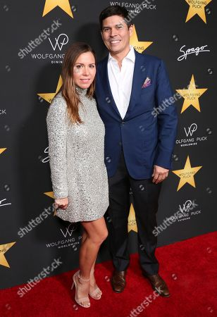 Stock Photo of Monique Lhuillier, left, and Tom Bugbee arrive at the Wolfgang Puck's Post-Hollywood Walk of Fame Star Ceremony Celebration at Spago, in Beverly Hills, CA
