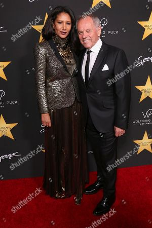 Gelila Assefa, left, and Wolfgang Puck arrive at the Wolfgang Puck's Post-Hollywood Walk of Fame Star Ceremony Celebration at Spago, in Beverly Hills, CA