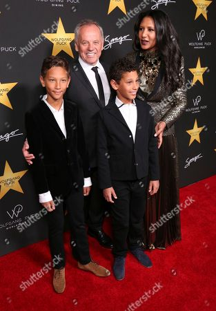 Wolfgang Puck, second left, Gelila Assefa, Alexander Wolfgang Puck and Oliver Wolfgang Puck arrive at the Wolfgang Puck's Post-Hollywood Walk of Fame Star Ceremony Celebration at Spago, in Beverly Hills, CA
