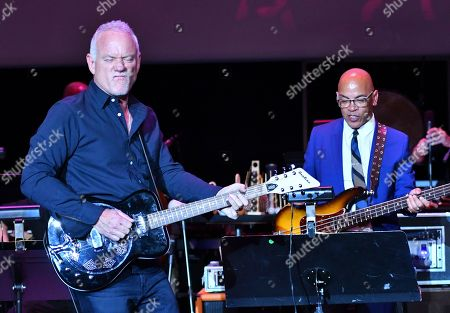 Composer John Debney, left, and Rickey Minor perform the score from Bonnie & Clyde during WORDS + MUSIC, presented at the Television Academy's Wolf Theatre at the Saban Media Center in North Hollywood, Calif