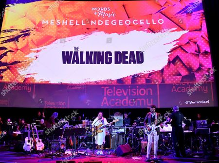 Conductor Mark Watters, from right, Christopher Bruce and composer Meshell Ndegeocello perform the score from Walking Dead during WORDS + MUSIC, presented at the Television Academy's Wolf Theatre at the Saban Media Center in North Hollywood, Calif