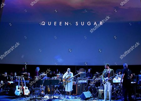 Composer Meshell Ndegeocello, center, performs the score from Queen Sugar during WORDS + MUSIC, presented at the Television Academy's Wolf Theatre at the Saban Media Center in North Hollywood, Calif