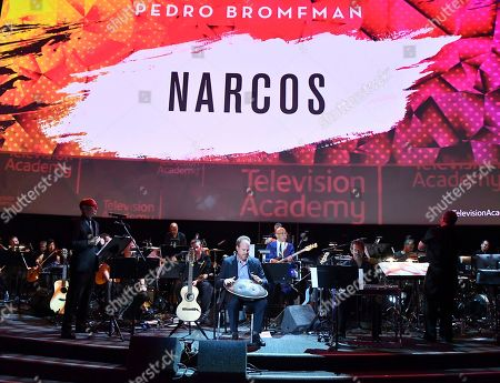 Composer Pedro Bromfman, center, performs the score from Narcos during WORDS + MUSIC, presented at the Television Academy's Wolf Theatre at the Saban Media Center in North Hollywood, Calif