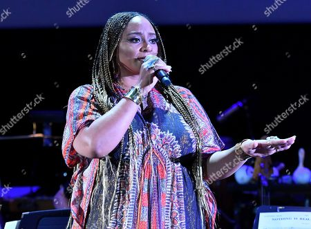 Stock Picture of Taura Stinson performs from the score from Underground, composed by Laura Karpman and Raphael Saadiq, during WORDS + MUSIC, presented at the Television Academy's Wolf Theatre at the Saban Media Center in North Hollywood, Calif