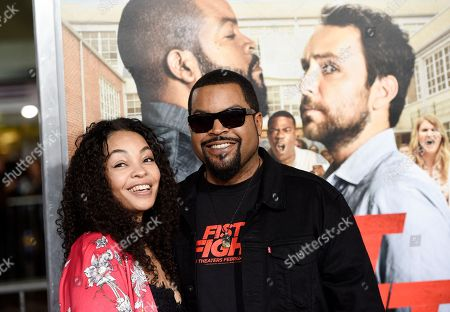 "Ice Cube, a cast member in ""Fist Fight,"" poses with his wife Kimberly Woodruff at the premiere of the film, in Los Angeles"
