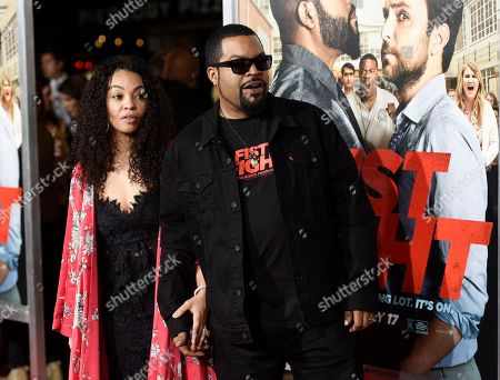 "Ice Cube, a cast member in ""Fist Fight,"" arrives with his wife Kimberly Woodruff at the premiere of the film, in Los Angeles"