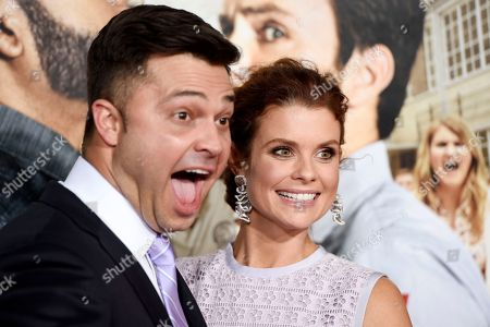 """JoAnna Garcia Swisher, a cast member in """"Fist Fight,"""" poses with her husband, professional baseball player Nick Swisher, at the premiere of the film, in Los Angeles"""