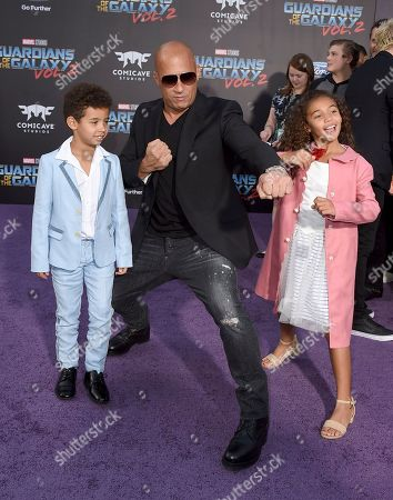 """Vin Diesel, center, and his children, form left, Vincent Sinclair and Hania Riley Sinclair arrive at the world premiere of """"Guardians of the Galaxy Vol. 2"""" at the Dolby Theatre, in Los Angeles"""