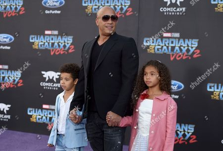 """Stock Photo of Vin Diesel, center, and his children, form left, Vincent Sinclair and Hania Riley Sinclair arrive at the world premiere of """"Guardians of the Galaxy Vol. 2"""" at the Dolby Theatre, in Los Angeles"""