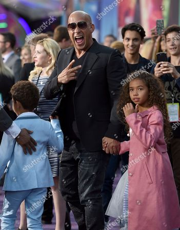 """Stock Picture of Vin Diesel, center, and his children, from left, Vincent Sinclair and Hania Riley Sinclair arrive at the world premiere of """"Guardians of the Galaxy Vol. 2"""" at the Dolby Theatre, in Los Angeles"""