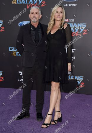 """Tommy Flanagan, left, and Dina Livingston arrive at the world premiere of """"Guardians of the Galaxy Vol. 2"""" at the Dolby Theatre, in Los Angeles"""