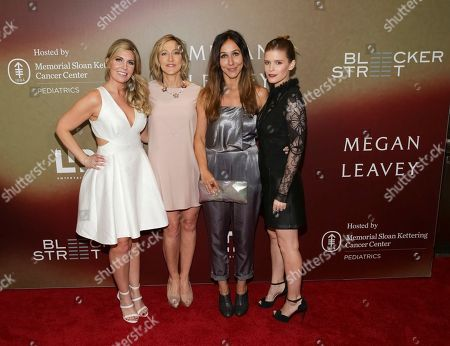 """Retired U.S. Marine Corp. Megan Leavey, from left, Actress Edie Falco, Director Gabriela Cowperthwaite and Actress Kate Mara attend the world premiere of """"Megan Leavey"""" at Yankee Stadium, in New York"""