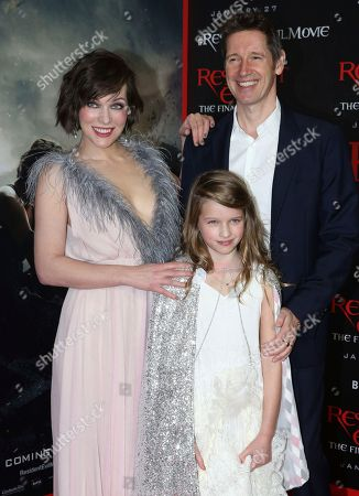 """Writer/director Paul W.S. Anderson, from right, Milla Jovovich and their daughter Ever Gabo Jovovich-Anderson arrive at the world premiere of """"Resident Evil: The Final Chapter"""" at Regal L.A. Live, in Los Angeles"""