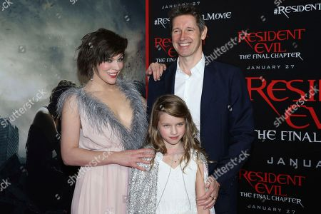"""Stock Image of Writer/director Paul W.S. Anderson, from right, Milla Jovovich and their daughter Ever Gabo Jovovich-Anderson arrive at the world premiere of """"Resident Evil: The Final Chapter"""" at Regal L.A. Live, in Los Angeles"""