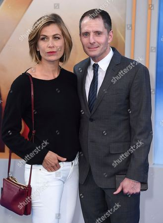 """Sonya Walger, left, and Allan Heinberg arrive at the world premiere of """"Wonder Woman"""" at the Pantages Theatre, in Los Angeles"""