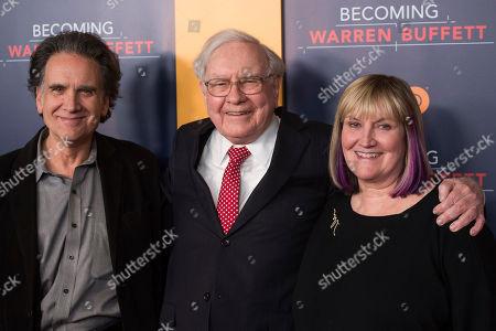 """Peter Buffett, left, Warren Buffett and Susie Buffett attend the world premiere screening of HBO's """"Becoming Warren Buffett"""" at The Museum of Modern Art, in New York"""