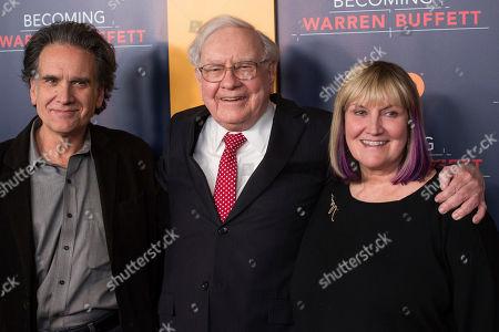 "Stock Photo of Peter Buffett, left, Warren Buffett and Susie Buffett attend the world premiere screening of HBO's ""Becoming Warren Buffett"" at The Museum of Modern Art, in New York"