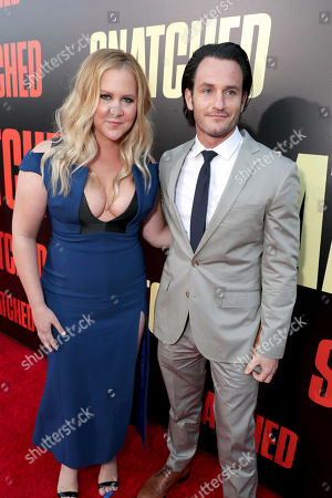 """Executive Producer/Actor Amy Schumer and Kevin Kane seen at World Premiere of Twentieth Century Fox """"Snatched"""" at Regency Village Theatre, in Los Angeles"""