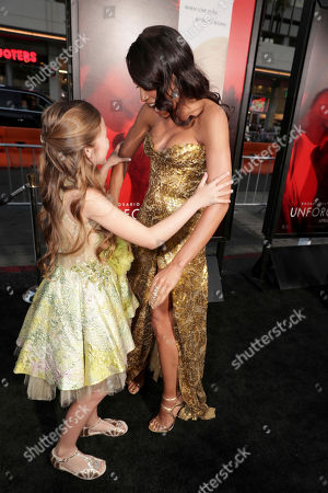 "Isabella Kai Rice and Rosario Dawson seen at Los Angeles World Premiere of Warner Bros. Pictures' ""Unforgettable"" at TCL Chinese Theatre, in Los Angeles"