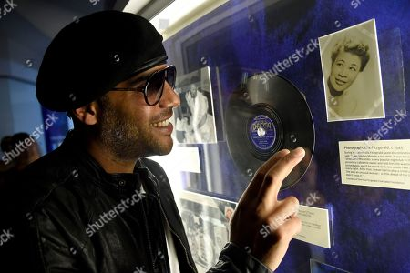 "Miles Mosley speaks during an interview at a sneak preview of ""Ella at 100: Celebrating the Artistry of Ella Fitzgerald"" at The Grammy Museum at L.A. Live, in Los Angeles"