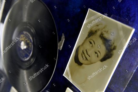 "A portrait of Ella Fitzgerald and a 78 record of ""There's Frost On The Moon""/ ""Love, You're Just A Laugh"" is displayed at a sneak preview of ""Ella at 100: Celebrating the Artistry of Ella Fitzgerald"" at The Grammy Museum at L.A. Live, in Los Angeles"