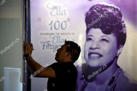"Steve Terceros works on an installation at a sneak preview of ""Ella at 100: Celebrating the Artistry of Ella Fitzgerald"" at The Grammy Museum at L.A. Live, in Los Angeles"