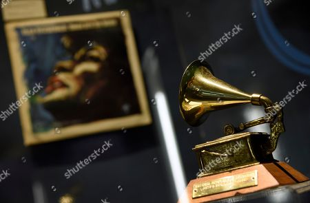 "Ella Fitzgerald's Grammy for best female vocal performance, awarded in 1958, is displayed at a sneak preview of ""Ella at 100: Celebrating the Artistry of Ella Fitzgerald"" at The Grammy Museum at L.A. Live, in Los Angeles. Pictured in background is Fitzgerald's album ""These Are The Blues"