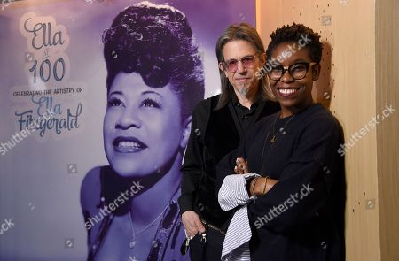 "Scott Goldman, executive director of The Grammy Museum at L.A. Live, and Nwaka Onwusa, curator of the Grammy Museum at L.A. Live, pose for a portrait at a sneak preview of ""Ella at 100: Celebrating the Artistry of Ella Fitzgerald"" at The Grammy Museum at L.A. Live, in Los Angeles"