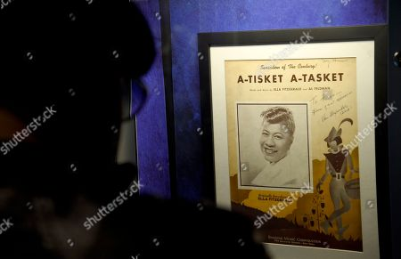 "A guest views sheet music from ""A-Tisket A-Tasket"" on display at a sneak preview of ""Ella at 100: Celebrating the Artistry of Ella Fitzgerald"" at The Grammy Museum at L.A. Live, in Los Angeles"