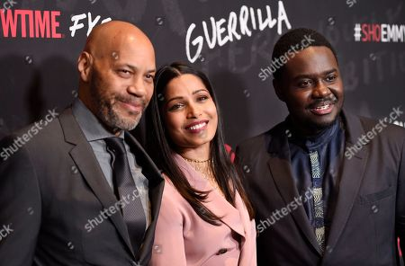 """John Ridley, left, executive producer of """"Guerrilla,"""" poses with cast members Freida Pinto, center, and Babou Ceesay at a """"For Your Consideration"""" event for the Showtime series at the Writers Guild of America, in Beverly Hills, Calif"""