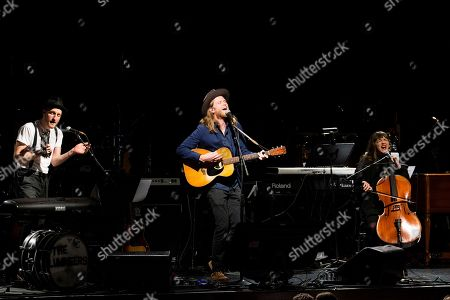 Jeremiah Fraites, left, Wesley Schultz, and Neyla Pekarek perform at The 13th Annual MusiCares MAP Fund Benefit Concert at The Playstation Theater, in New York