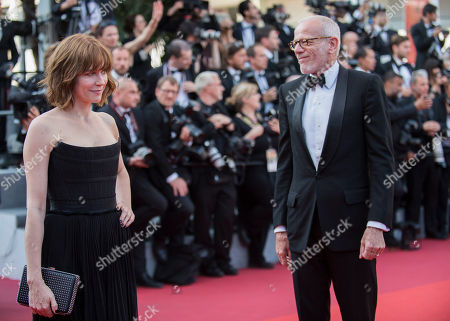 Marie-Josee Croze and Pascal Greggory pose for photographers upon arrival at the screening of the film Based On A True Story at the 70th international film festival, Cannes, southern France