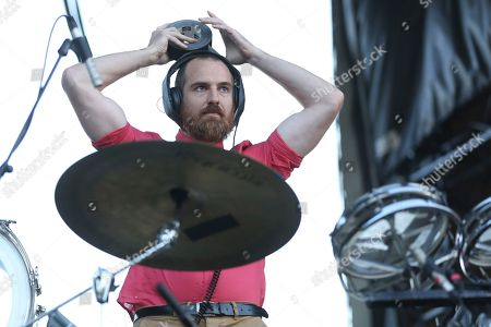 Stock Image of Artist Darren King of Mutemath tapes on his headphones before his performance on the Bud Light Stage of the 2017 Beale Street Music Festival on in Memphis, Tenn