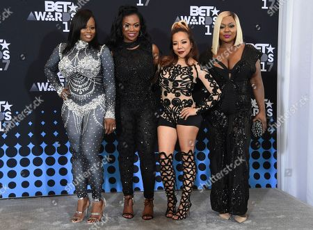 "Tamika Scott, from left, Kandi Burruss, Tameka ""Tiny"" Cottle, and LaTocha Scott, members of Xscape, pose in the press room at the BET Awards at the Microsoft Theater, in Los Angeles"